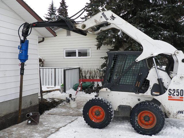 white-bobcat-pouring-cement