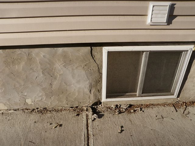 Crack in home's foundation near basement window